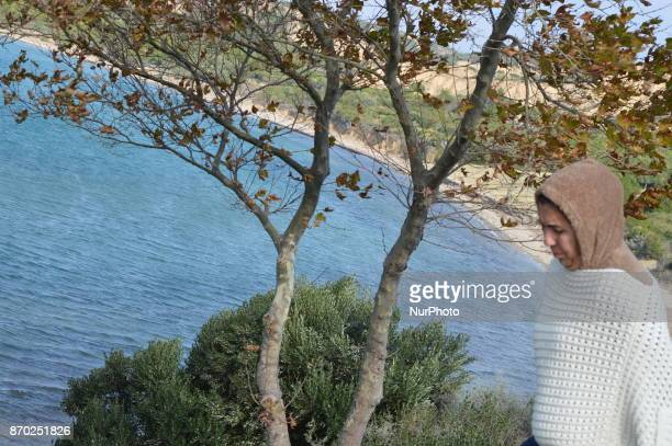 A woman walks at Anzac Cove on the Gallipoli peninsula in Canakkale Turkey on November 4 2017 ''Turkey is currently ranked sixth in the tourism...