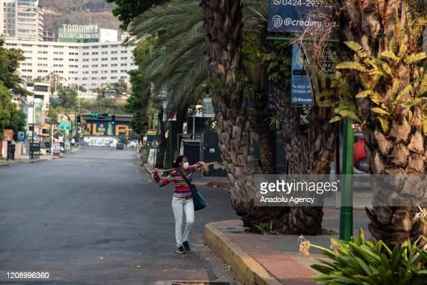 A woman walks at Principal Avenue of Las Mercedes as a preventive measure against the new type of coronavirus pandemic in Caracas Venezuela on April...