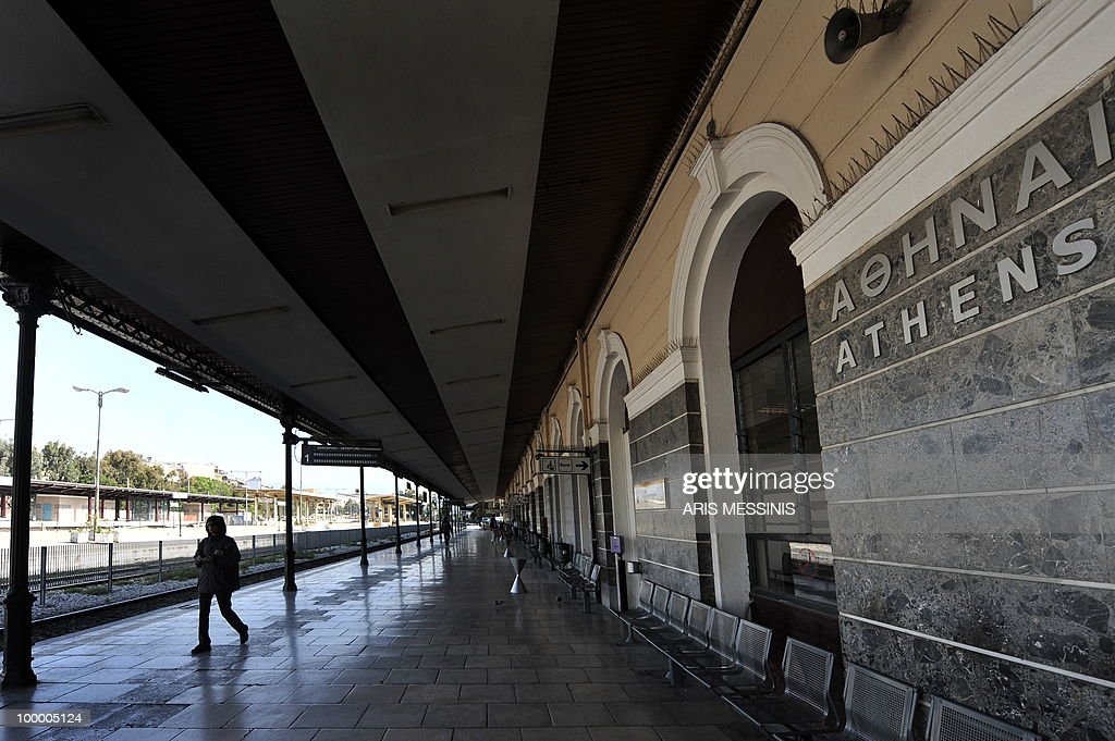 A woman walks at the empty Athens' train station during a 24-hour general strike on May 20, 2010. Greece on May 19 averted default by tapping into a multi-billion-euro EU loan rescue as unions geared up for a new general strike and official figures showed a strong rise in government debt.