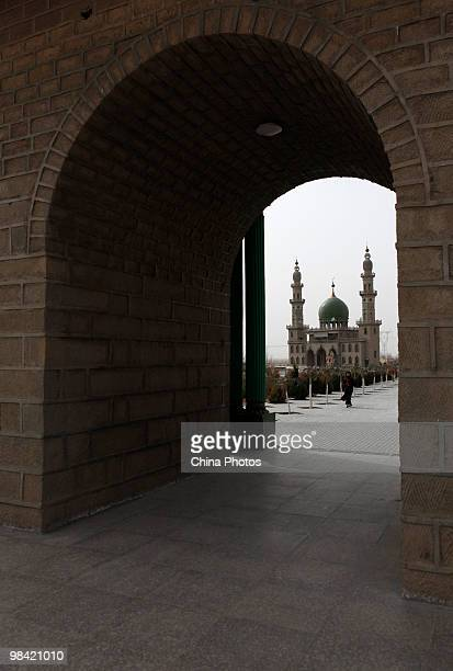 A woman walks at the Muslim domeshaped tombs on March 14 2010 in Xihaigu Tongxin County of Ningxia Hui Autonomous Region north China Xihaigu is the...