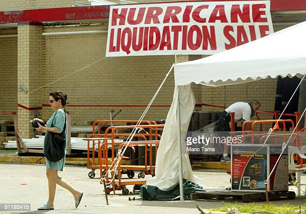 "Woman walks away from a ""Hurricane Liquidation Sale"" August 19, 2004 in Punta Gorda, Florida. Price gouging has become a problem for Floridians..."