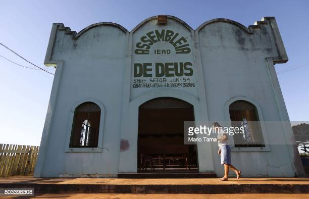 A woman walks before Sunday services at an evangelical church located in a partially deforested section of the Amazon rainforest on June 25 2017 near...