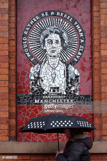 A woman walks beneath a mosiac of Emmeline Pankhurst outside Affleck's Palace in the Northern Quarter on February 6 2018 in Manchester England On...