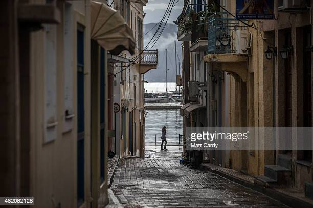 Woman walks besides the harbour on the island of Aegina ahead of the general election tomorrow on January 24, 2015 near Athens, Greece. According to...