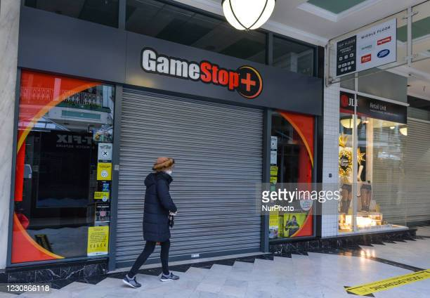 Woman walks by a closed GameStop shop in Stephen's Green Shopping Centre in Dublin. In January 2021, a short squeeze caused GameStop stock to surge...