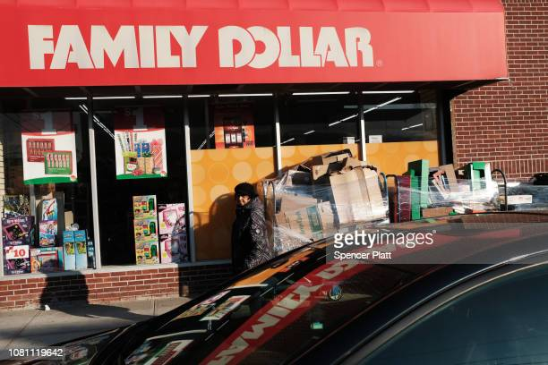 A woman walks by a Family Dollar store on December 11 2018 in the Brooklyn borough of New York City As the income gap between rich and poor continues...