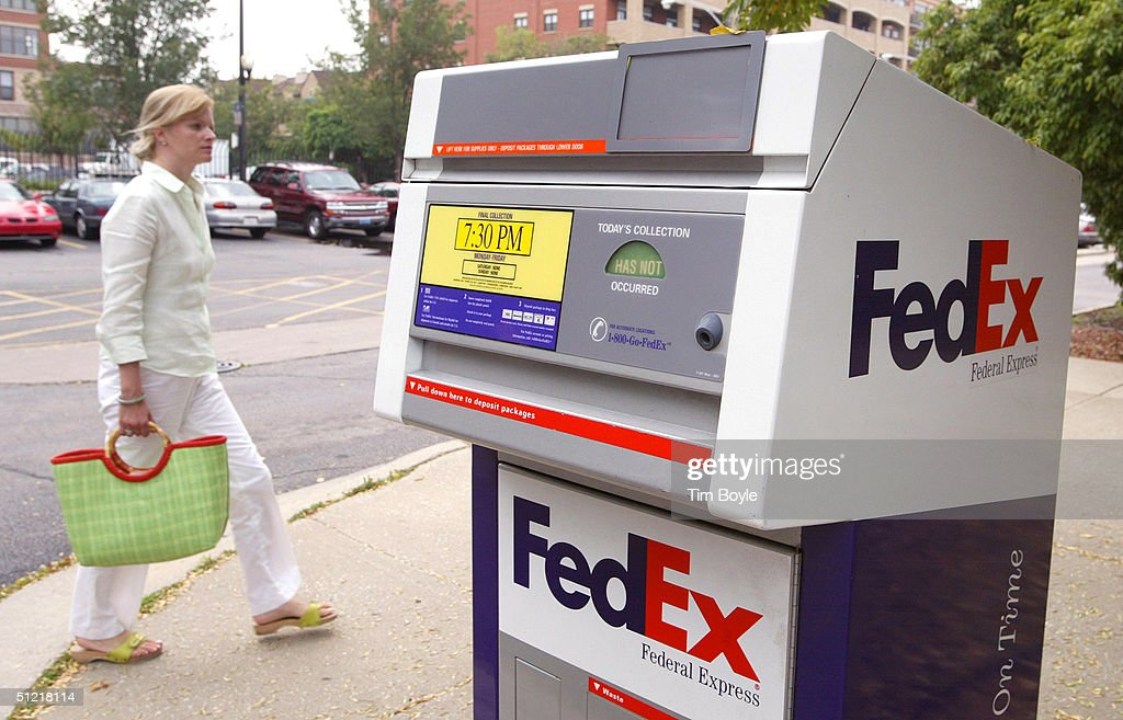 A woman walks by a FedEx drop box August 25 2004 in Chicago Illinois & FedEx Raises 2005 Profit Forecast Photos and Images | Getty Images Aboutintivar.Com
