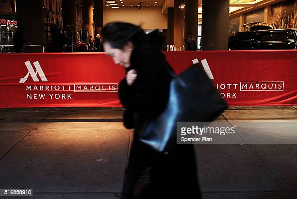 A woman walks by a Marriott hotel in midtown Manhattan on March 21 2016 in New York City Starwood Hotels Resorts Worldwide accepted a $136 billion...