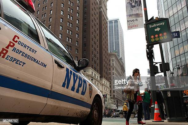 Woman walks by a New York City Police Department vehicle on April 6, 2010 in New York City. Following a melee involving groups of youths around Times...