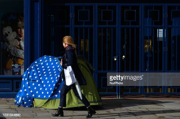 Woman walks by a rough sleeper's tent on Grafton Street in Dublin city center during Level Five Covid-19 lockdown. The Taoiseach Micheal Martin has...