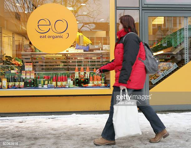 A woman walks by a store of German organic supermarket chain EO Komma March 2 2005 in Berlin Germany According to the Londonbased organization...