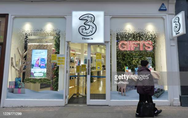Woman walks by a Three.ie shop on Grafton Street during the level 5 lockdown. On Tuesday, November 24 in Dublin, Ireland.