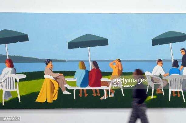 A woman walks by Alex Katz's work 'Beach Stop' from the year 2001 in museum Frieder Burda in BadenBaden Germany 7 December 2017 This is a piece of...