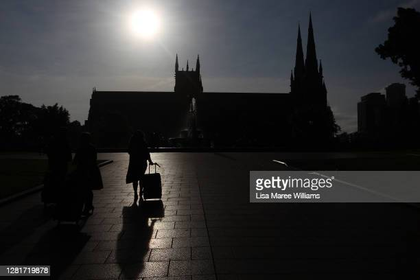 A woman walks by St Mary's Cathedral on October 23 2020 in Sydney Australia Religious communities across New South Wales are welcoming the...