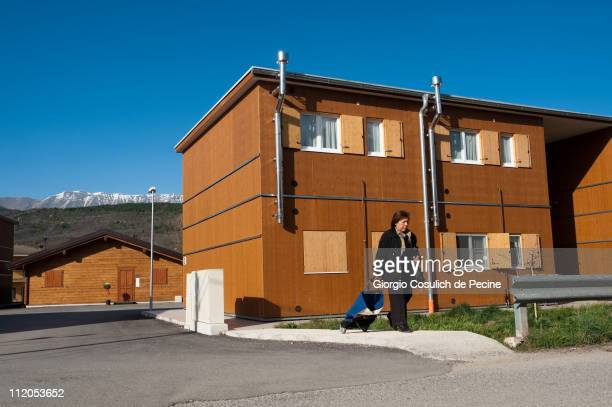 Woman walks by temporary housing units near the village of Tempera, two years on from the April 6, 2009 earthquake that struck the Abruzzo region of...