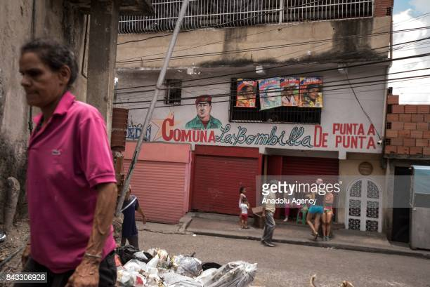 A woman walks by the Sector Antonio Jose de Sucre part of the Petare Slum the biggest favela of Venezuela with more than 1 million habitants in...