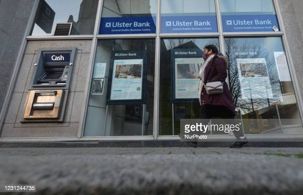Woman walks by the Ulster Bank branch in Dublin center during Level 5 COVID-19 lockdown. Tomorrow, Friday 19 February, NatWest, the British bank that...