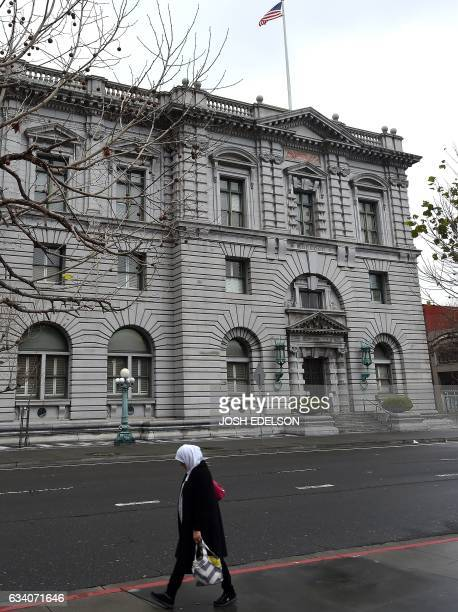 A woman walks by the United States Court of Appeals for the Ninth Circuit building February 6 2017 in San Francisco California where on February 7...