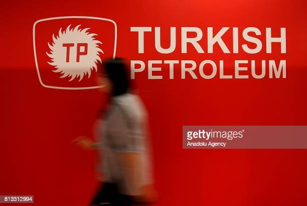 A woman walks by 'Turkish Petroleum' logo during the 22nd World Petroleum Congress at Lutfi Kirdar International Convention and Exhibition Center in...