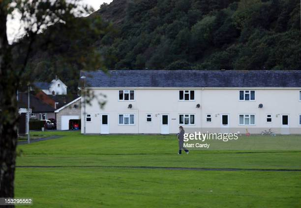 A woman walks close to the home of missing child April Jones on October 3 2012 in Machynlleth Wales The fiveyearold girl was abducted while playing...
