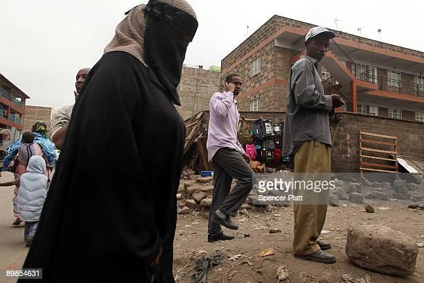 Woman walks down a market street in Eastleigh, a predominantly Muslim Somali neighborhood on August 18, 2009 in Nairobi, Kenya. Referred to locally...