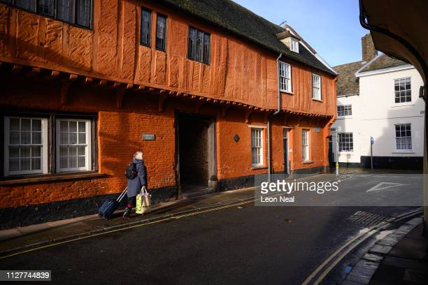 A woman walks down a road of medieval buildings on February 06 2019 in King's Lynn England The seaport town of Lynn grew rapidly through the 1100s...