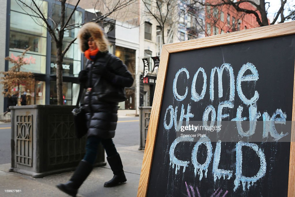 A woman walks down a street on one of the coldest days of the year on January 23, 2013 in New York City. Much of the Northeast, will be experiencing colder than usual temperatures for the remainder of the week with temperatures in the 20's and a wind chill feeling in the single digits.