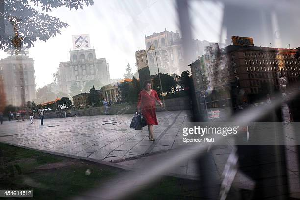 Woman walks down a street on September 4, 2014 in Kiev, Ukraine. The square was the famed site of the protests that eventually led to the February...