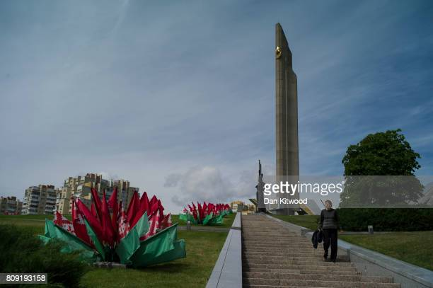 A woman walks down from an Obelisk to 'Hero City' near the Great Patriotic War Museum on July 01 2017 in Minsk Belarus Independence Day also known as...