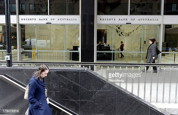 A woman walks down stairs as another walks past the Reserve Bank of Australia headquarters in the central business district of Sydney Australia on...