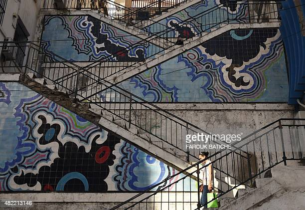 A woman walks down stairs in the centre of the Algerian capital Algiers on July 28 2015 AFP PHOTO / FAROUK BATICHE