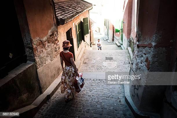 A woman walks down the old town on July 13 2016 in Sibiu Romania