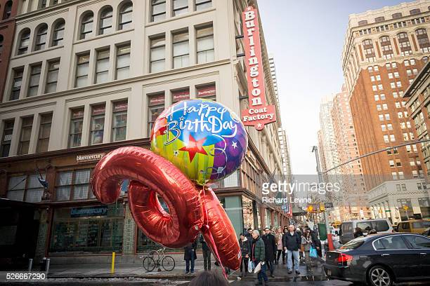 A woman walks down the street in Chelsea in New York with Happy Birthday balloons in hand on Tuesday January 26 2016 Music publisher Warner/Chappell...