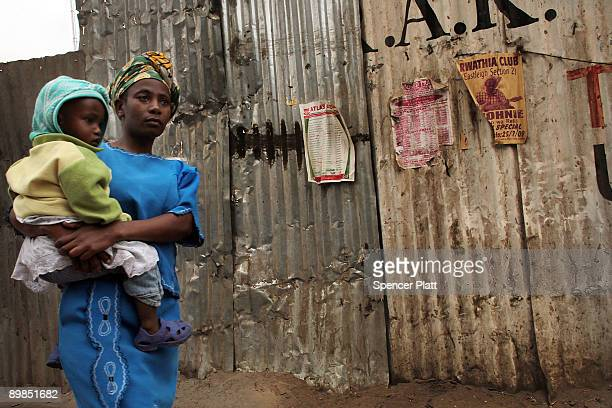 A woman walks down the street in Eastleigh a predominantly Muslim Somali neighborhood on August 18 2009 in Nairobi Kenya Referred to locally as...