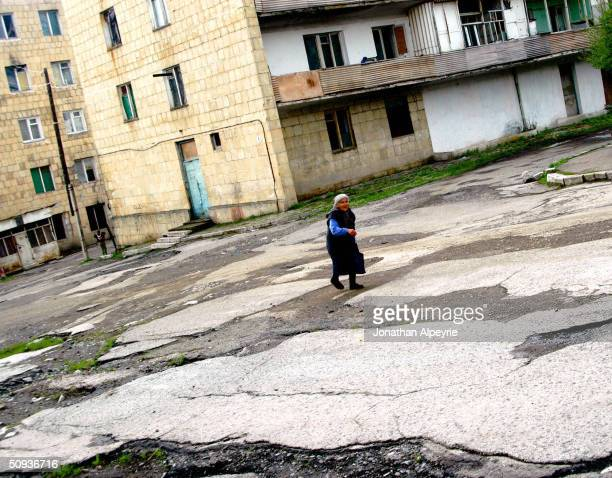 Woman walks down the street near buildings in the western part of the town of Shushi May 4, 2004 in Nagorno-Karabakh, Azerbaijan. The town was...