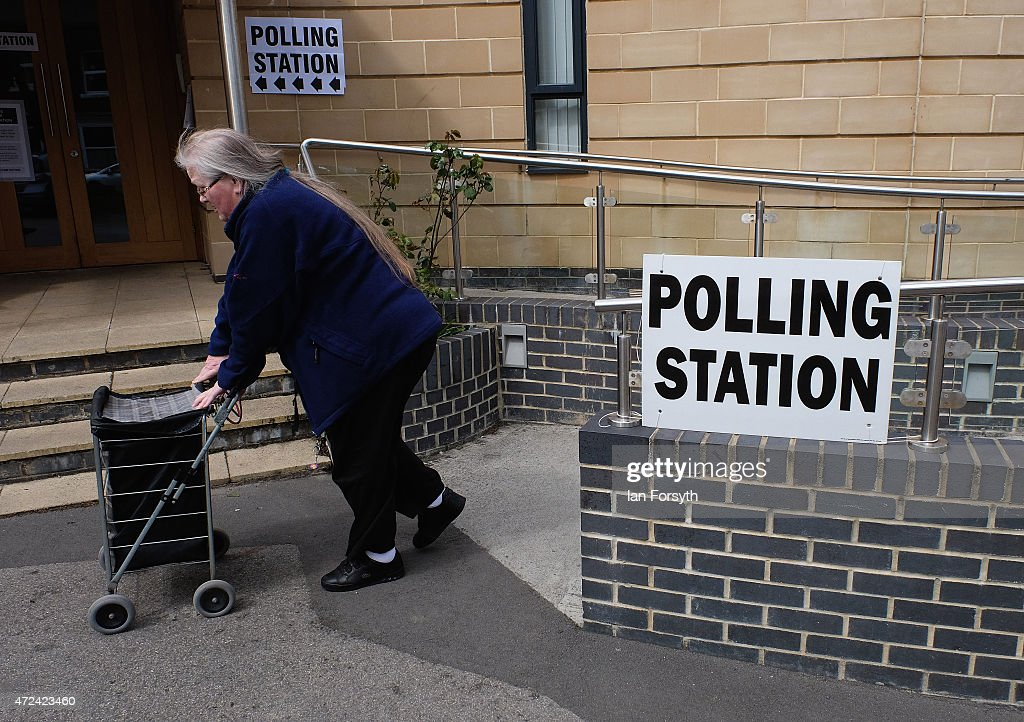 A woman walks from a polling station situated in Emmanuelle Church on May 7, 2015 in Saltburn, England. The United Kingdom has gone to the polls to vote for a new government in one of the most closely fought General Elections in recent history. With the result too close to call it is anticipated that there will be no overall clear majority winner and a coalition government will have to be formed once again.