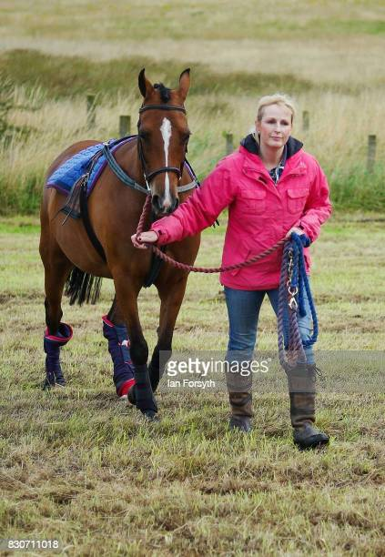 A woman walks her horse after arriving at the 194th Sedgefield Show on August 12 2017 in Sedgefield England The annual show is held on the second...