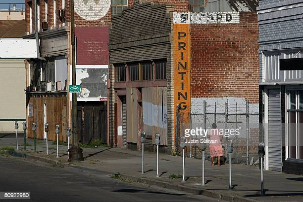 Woman walks in a deserted section of the downtown area April 29, 2008 in Stockton, California. As the nation continues to see widespread home loan...