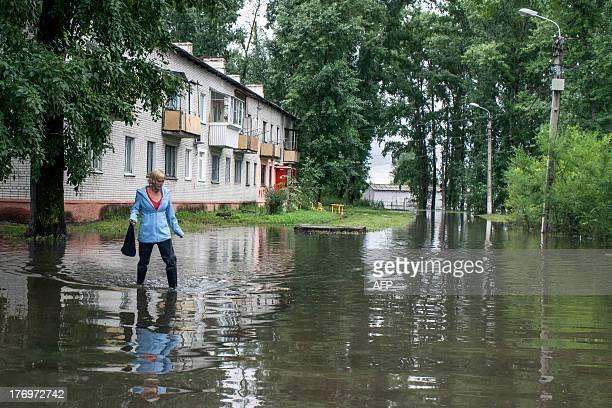 A woman walks in a flooded street in the village of Bolshoi Ussuriysky island close to city of the Khabarovsk in Russia's Far Eastern Amur region on...