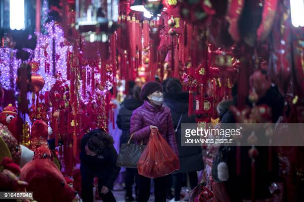 A woman walks in a shop with lantern decorations at Yu Yuan Garden in Shanghai on February 10 ahead of the coming Lunar New year marking the Year of...