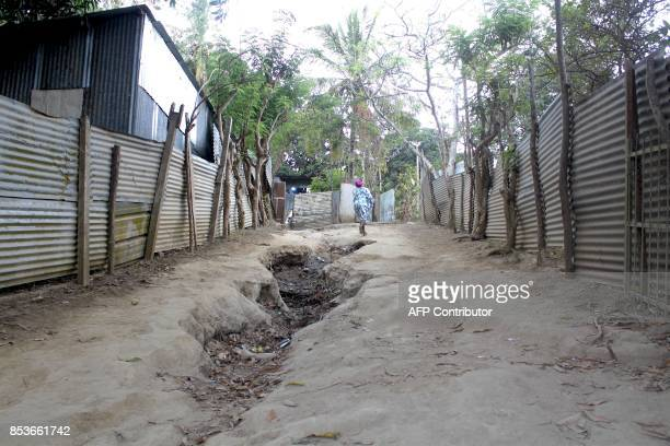 A woman walks in a street of La Vigie in PetiteTerre on the Mozambique channel French archipelago of Mayotte on September 22 as a census campaign is...