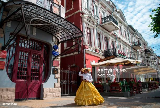 A woman walks in a street of Voronezh on June 15 during the Russia 2018 World Cup football tournament