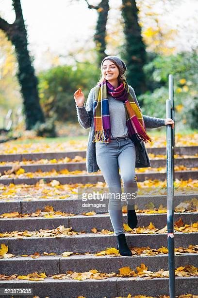 Woman walks in autumn
