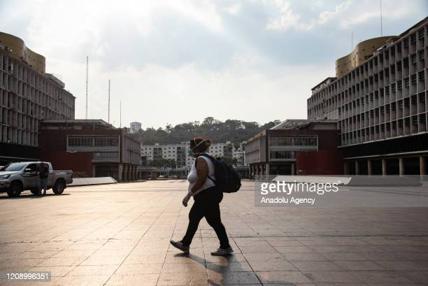 A woman walks in empty Caracas Square as a preventive measure against the new type of coronavirus pandemic in Caracas Venezuela on April 02 2020