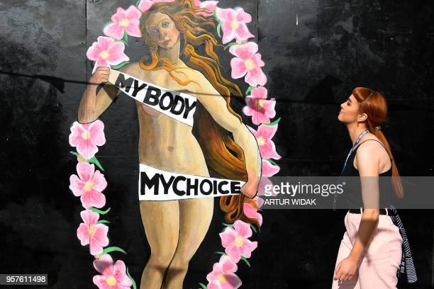 A woman walks in front of a prochoice mural relating to the laws regarding abortion in Dublin on May 11 2018 ahead of the referendum Ireland will...