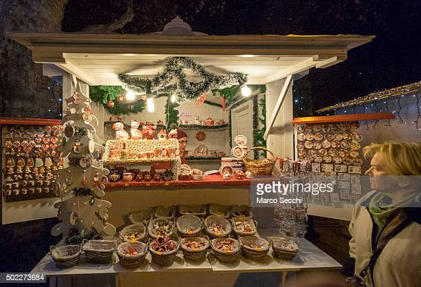 A woman walks in front of a stall at the Advent Market in the city centre on December 22 2015 in Zagreb Croatia Zagreb was voted last week European...