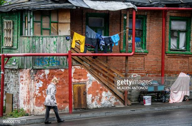 TOPSHOT A woman walks in front of an old house in the southern Russian city of RostovonDon on May 13 2018 Rostov will host five football matches of...
