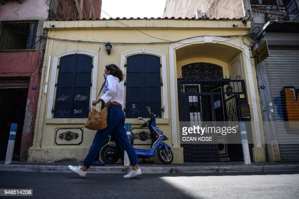 A woman walks in front of 'Dirilis Church' in which US pastor Andrew Brunson had his congregation in Izmir Turkey on April 15 2018 Andrew Brunson an...