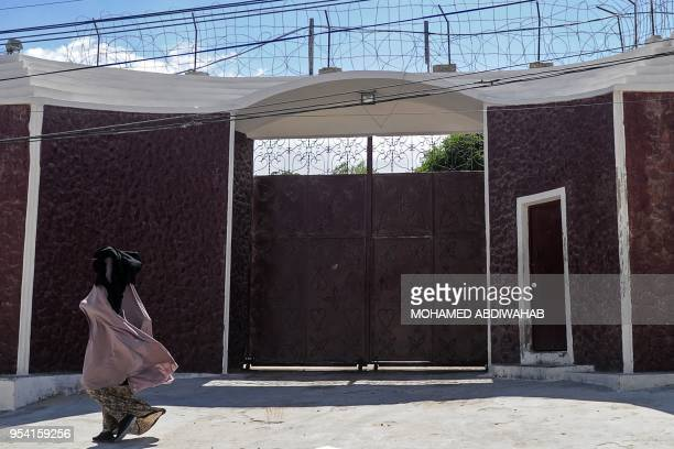 TOPSHOT A woman walks in front of the compound of the International Committee of the Red Cross where armed men kidnapped a German nurse on May 3...