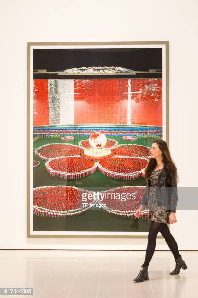 A woman walks in front of the image entitled 'PyongyangVII' by Andreas Gursky in the reopened Hayward Gallery on January 24 2018 in London England